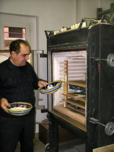 Deruta potter Eugenio Ricciarelli inspects his serving bowls