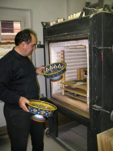 Deruta potter Eugenio Ricciarelli inspects his fruit bowls