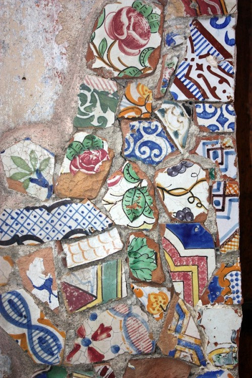 Sicilian tile shards plastered on the wall - detail